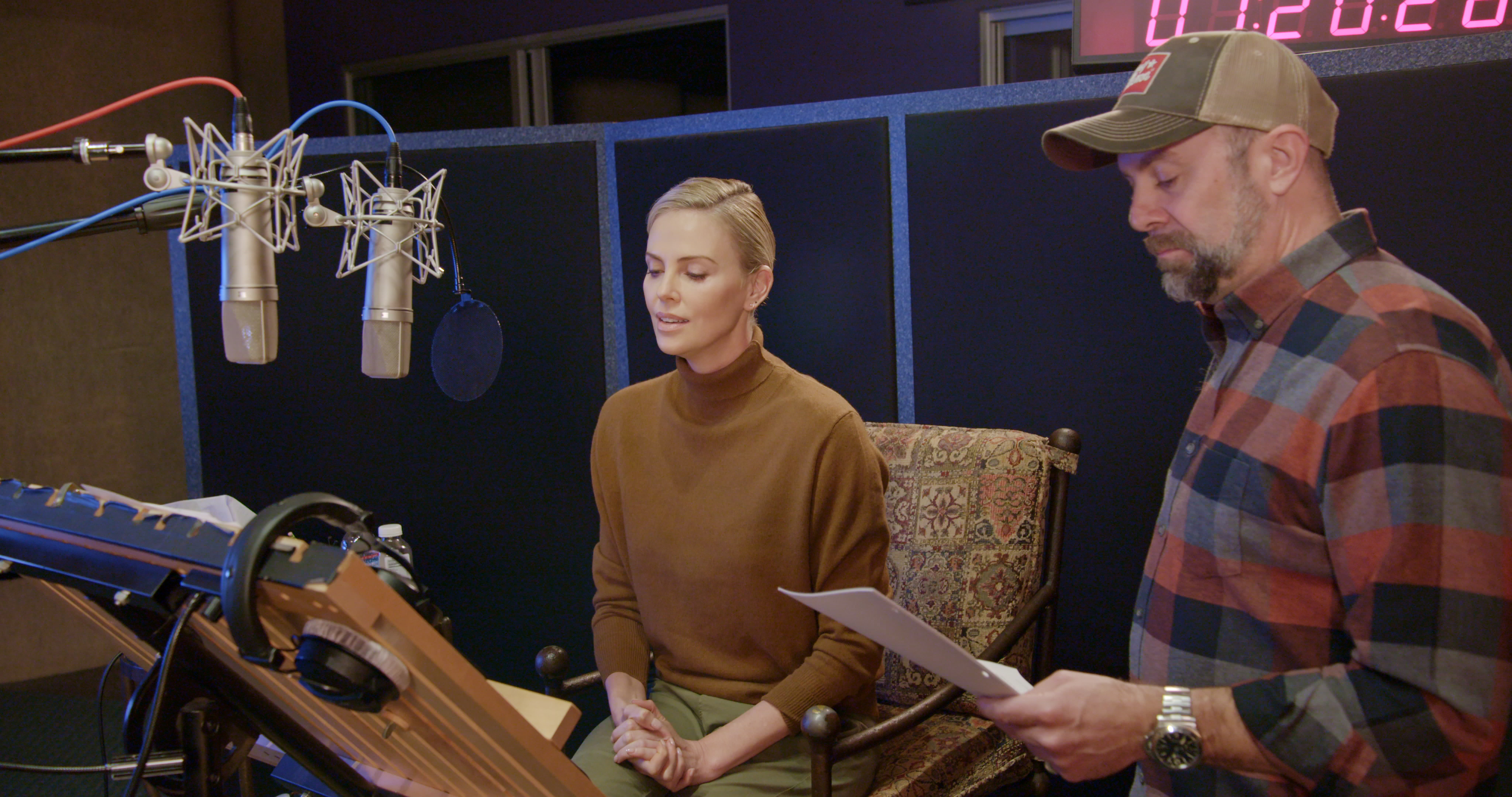 Charlize Theron (left) stars as the voice of Morticia Addams and director Conrad Vernon (right) during a recording session of THE ADDAMS FAMILY, directed by Conrad Vernon and Greg Tiernan, a Metro Goldwyn Mayer Pictures film. Credit: Metro Goldwyn Mayer Pictures © 2019 Metro-Goldwyn-Mayer Pictures Inc. All Rights Reserved.